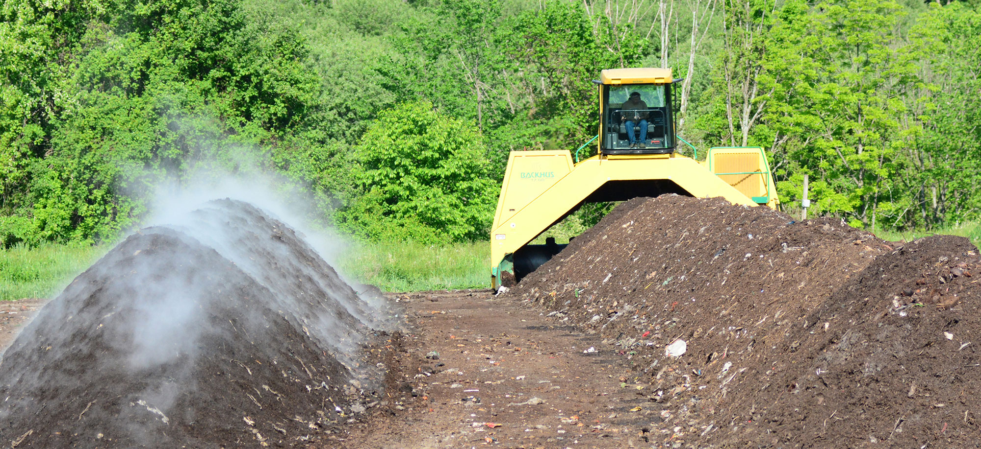 A Backhus is Used to Aerate the Compost